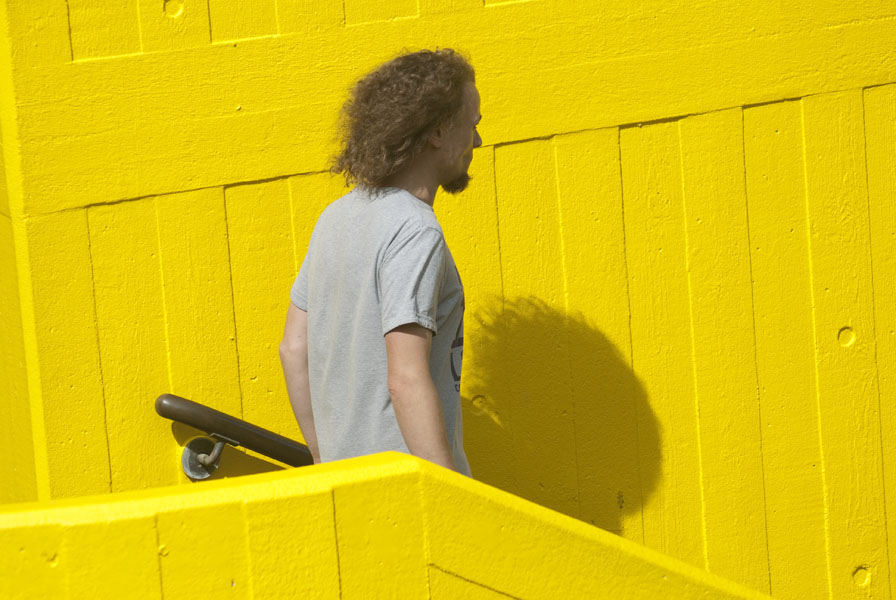 Man and shadow, yellow background